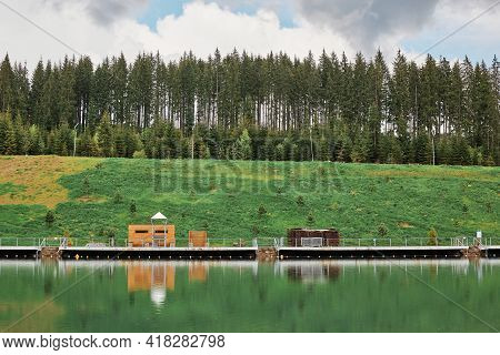 View Of Idyllic Colorful Scenery, Beautiful Landscape, Cloudy Day, River Near Green Meadow And Fores
