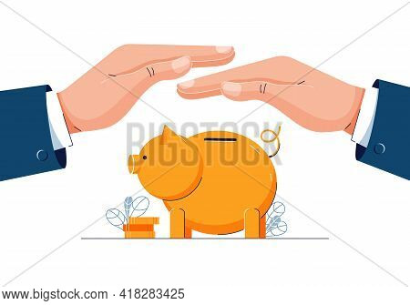 Protect Your Money Concept. Businessman Is Holding Hands Over The Piggy Bank To Protect Savings. Pig