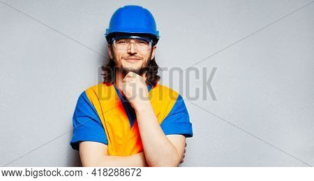 Panoramic Portrait Of Young Construction Worker Engineer Wearing Safety Equipment; Blue Hard Hat, Tr