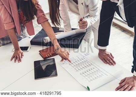 Architect And Engineer Working With Construction Drawing Project On Table In Office. Architecture An