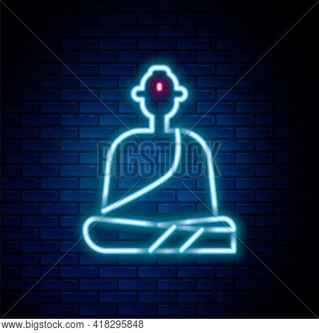 Glowing Neon Line Buddhist Monk In Robes Sitting In Meditation Icon Isolated On Brick Wall Backgroun