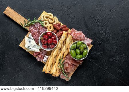 Appetizers Board With Assorted Italian Snacks. Gorgonzola Cheese, Meat, Olives, And Peppers. Charcut