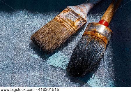 Close Up Of Two Old And Rusty Paintbrushes