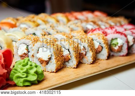 Set Of Various Sushi Rolls On A Board. Close-up, Selective Focus