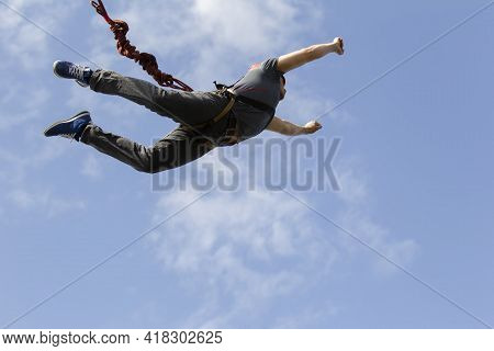 03 June 2018 Belarus. Gomil. Rope Jumping. A Man Jumps From A Bridge On A Rope. Extreme Sports.