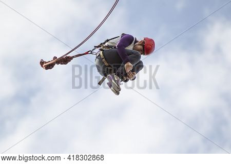03 June 2018 Belarus. Gomil. Rope Jumping. Woman Jumping From A Bridge On A Rope. Extreme Sports.