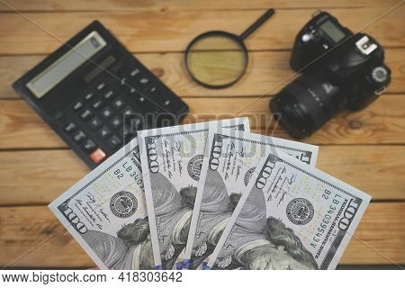 Calculator, Digital Camera And Money, Store Selling Photographic Equipment, Pawnshop, Closeup