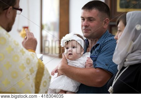 July 15, 2020, Belarus, The City Of Gomil, A Church In The City. Baptism Of The Child. The Priest Re