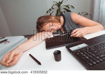 Young Woman Sleeping In The Workplace. Fatigue And Overload In Office Work. View From The Top.