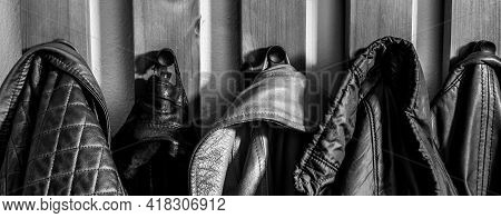 Close Up Of Jackets And Coats On A Coat Rack In Black And White