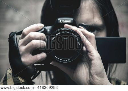 Editorial, Belarus - 25 January, 2019: Photographer With Canon Camera Close Up