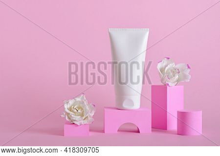 Beauty Natural Skincare Product Mock Up. Cream Tube And Flowers On Different Geometric Podiums. Body
