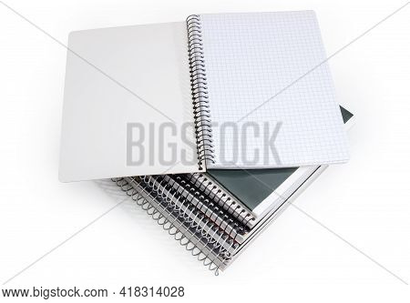 Open School Exercise Book With Sheets Of Squared Paper And Spiral Bindings Lies On Stack Of Similar