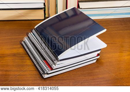 Stack Of The Different Thick School Exercise Books With Ordinary And Spiral Bindings On A Wooden Tab