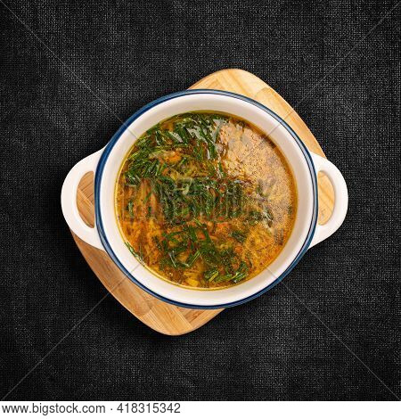 Flat Lay Of Chicken Soup On Dark Background
