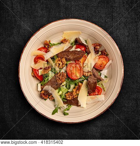 Grilled Beef Steak Salad With Parmesan, Walnuts And Green Lettuce
