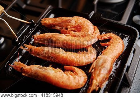 Grilled Large Shrimps With Lemon And On Grill Pan