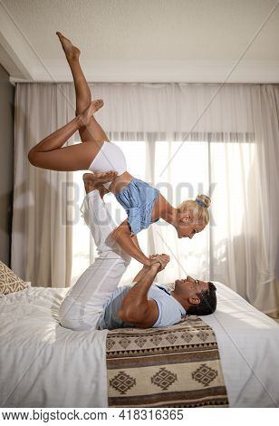 A Couple Man And Woman In The Room Number Doing The Acrobatic Yoga Stand With Upside-down Girl Pose