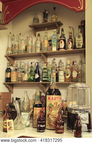 Elche, Alicante, Spain- March 28, 2021: Old Liquor Bottles And Utensils Of An Old Bar Of Elche, Exhi