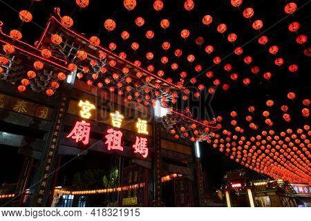 Puli Township, Taiwan -December 01, 2020: Puli Heng Ji Gong Matsu Temple with red lanterns in the night at Chinese altar, Taoist special dedication sacrificial ceremony , Nantou, Taiwan