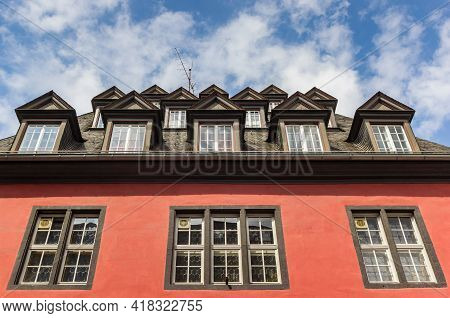 Many Windows On The Roof Of A Red Historic Building In Koblenz, Germany