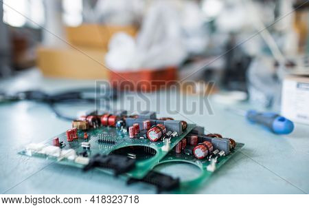 Close-up Electric Green Embedded Microcircuits In Production