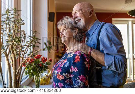 Senior Couple Looking Through Window