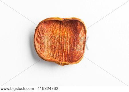Dried Red Fruit Peel On White Background