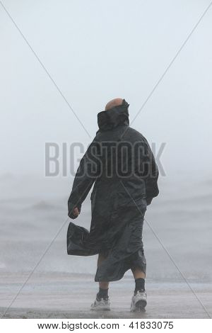 Brisbane, Australia - January 27 : Unidentified Man Braves The Elements During Ex Tropical Cyclone O