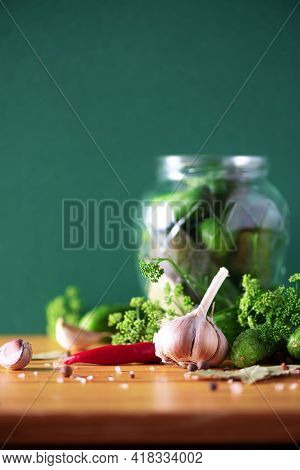 Pickling Cucumbers In Cans. Ingredients For Marinated Gherkins, Glass Jar, Garlic, Dill, Salt, Peppe