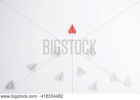 Leadership Concept With Red Paper Plane Going Ahead White Paper Planes On Abstract Light Background.