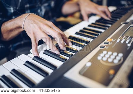 Close Up Of Pianist's Hands On The Keyboard