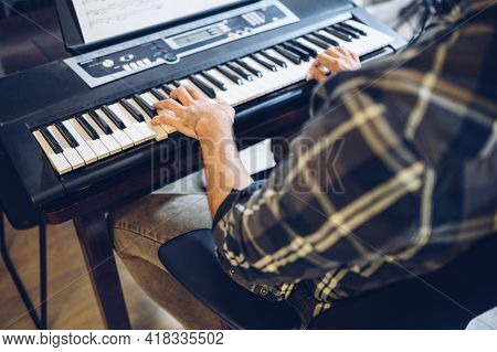 Amateur Pianist Practicing In His Home Studio.music Love Concept