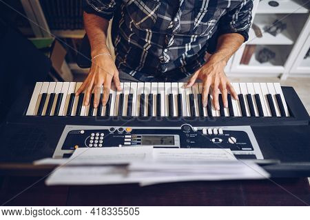 Top View Of A Pianist's Hands On The Piano Keyboard.