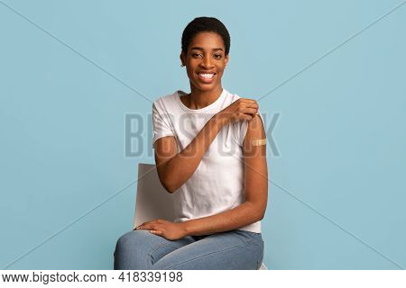 After Vaccination Concept. Vaccinated Black Woman Showing Arm After Coronavirus Vaccine Injection