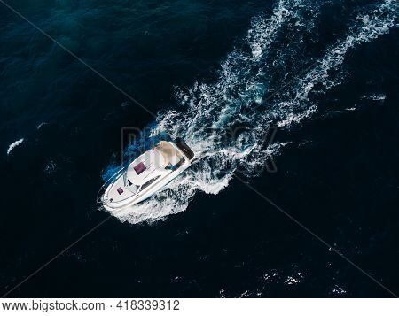 White Motorboat Floats On The Open Sea. View From Above