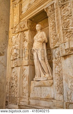 Antique statue at the facade of the Library of Celsus in the ancient city of Ephesus, Turkey. Ephesus is a UNESCO World Heritage site.