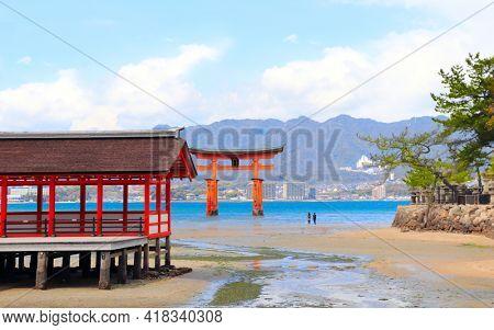 Pavilion of Itsukushima Shrine and Floating Torii gate (O-Torii), sacred Miyajima island, Hiroshima, Japan. UNESCO world heritage site. Focus on pavilion