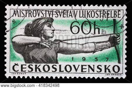 ZAGREB, CROATIA - SEPTEMBER 18, 2014: Stamp printed in Czechoslovakia shows shows Woman Archer, International Archery Championships, circa 1957
