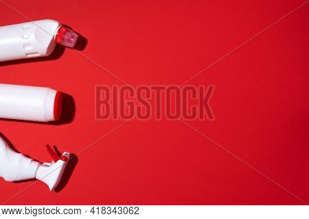 Cleaning Products Pattern On Red Background. Top View. Copy Space. Chemical Cleaning Supplies. Stop