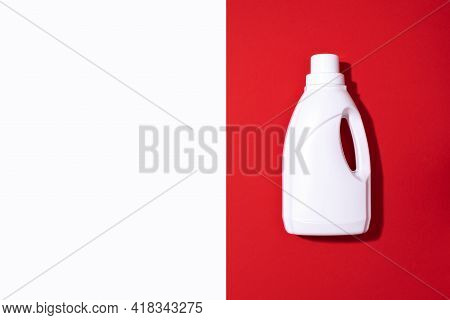 White Plastic Bottle Of Cleaning Product, Household Chemicals Or Liquid Laundry Detergent On Red Bac