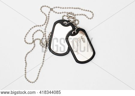Dog Tag, Army Chains, Army Badge On The Light Background.