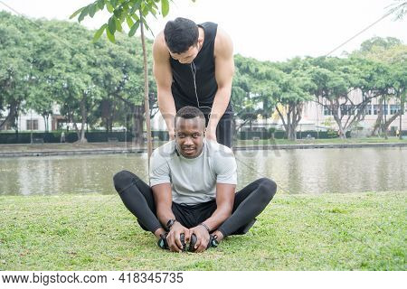 African And  Asian Muscular Young Men Friend Greet, Smile In Park. Man Athlete And Trainer Relax Tal