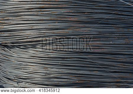 Wire Texture. The Part Made Of Steel Cord In The Factory. The Steel Wire Is Wound On A Bobbin. A Coi