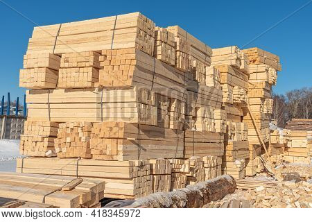 Preparation Of Lumber, Beams. A Stack Of Lumber Is A Wooden Beam Prepared For The Construction Of A