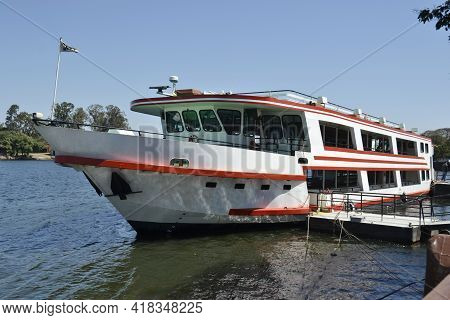 Tourist Boat Moored At Pier To Board Passengers For Sightseeing Tour On The Tiete River In Tourist C