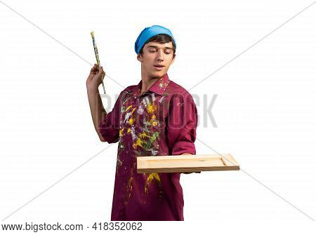 Young Handsome Painter Artist Holding Paintbrush And Canvas In Frame. Portrait Of Happy Painter Isol