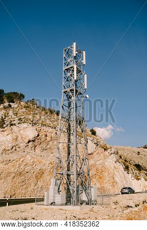 Cellular Base Station Near The Highway Against The Background Of Mountains