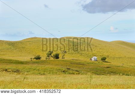 Lonely House At The Top Of A Hill With Some Clods On The Horizon At Terevaka Volcano, Easter Island,