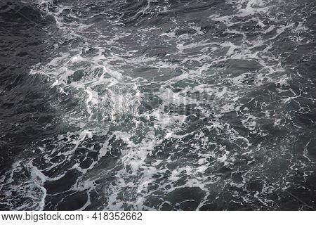 The Ocean Water With Surface Foamy Sunny Day, Texture Background.